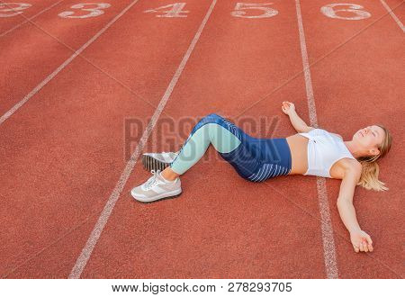 Tired Woman Runner Taking A Rest After Run Lying On The Running