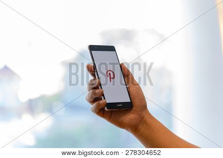 Chiang Mai, Thailand - Oct. 28,2018: Man Holding Huawei Mobile Phone With Pinterest Apps Login On Sc