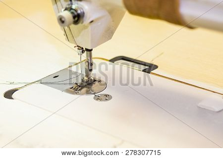 Presser foot sewing machines. Sewing machine in the workplace.Garment industry, designer atelier, tailoring process.Selective focus.Copy space.tailor workshop.technology, material, equipment concept. poster