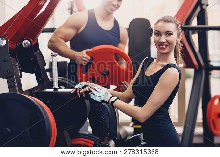 Girl Is Preparing The Exercise Training Apparatus. Smiling Girl Prepares Training Apparatus Before D