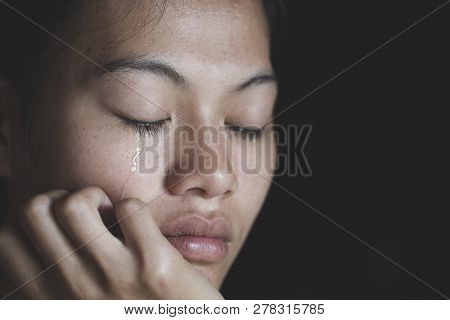 Sad Depressed Woman Suffering And From Family Life. Women Sitting In Dark Room And Crying, Young Bea