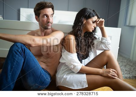 People, Relationship Difficulties, Conflict Concept - Unhappy Couple Having Problems At Bedroom