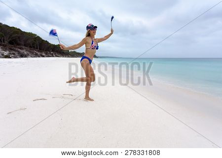 Patriotic Female On The Beach With Australian Flag On  Her Hat, Sunglasses And Bikini And She Is Als
