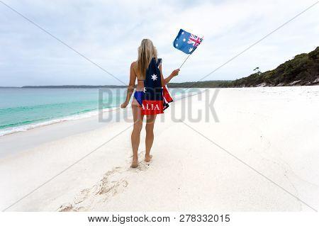 Aussie Blonde Woman Walking Along An Idyllic Beach Wearing A Bikini With Patriotic Australian Flag T