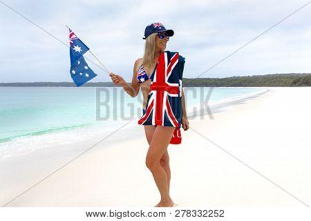Female Celebrating Australia Day Holding A Small Australian Flag, Wearing An Australian Flag On Her
