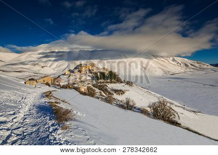 Wonderful And Panoramic View Of Castelluccio Di Norcia Village With Snow In The Winter Season, Umbri