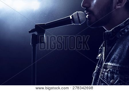 Male Singer Singing With Microphone On Stage