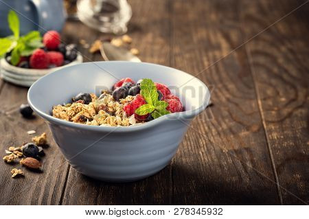 Homemade Oatmeal Granola Or Muesli With Yogurt And Fresh Berries For Healthy Morning Breakfast, Sele