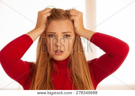 Young Blonde Woman Having Serious Migrene Suffering From Horrible Head Ache Feeling Horrible Pain.