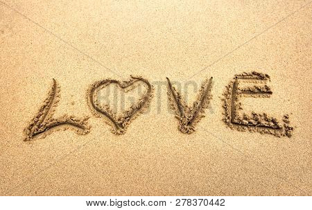 Love write in the sand