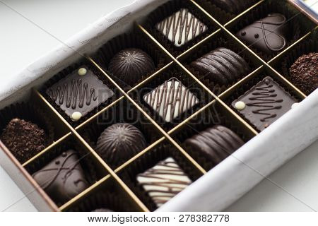 Assortment Of Chocolates In Box (selection Focus). Close Up Assortment Of Chocolate Candies In Box.