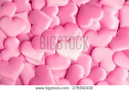 Valentine's Day hearts Background. Holiday Abstract Valentine Background with pink satin Heart. Hearts top view backdrop. Love concept, wedding. Flatlay