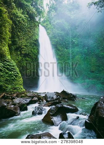 Powerful Waterfall With Fog. Tropical Forest And Nung Nung Waterfall