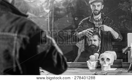 Man With Beard And Mustache In Hairdressers Chair In Front Of Mirror Background. Reflexion Of Barber