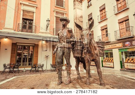 Granada, Spain - Nov 21: Historical Andalusian Street With Monument To Aguador With Donkey, Water Ca