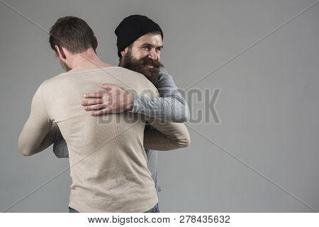 True Friendship. Happy Men In Friendly Relations. Best Friends Greeting Each Other. Bearded Man Shak