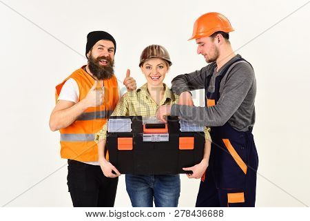Thumb Ups For Success. Construction Technicians With Building Tools. Men And Woman Builders In Workw
