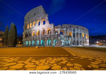 The Colosseum illuminated at night in Rome, Italy