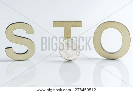 Security Token Offering Sto Sign With Wooden Letters And Silver Ethereum Coin, Ethereum Concept On W