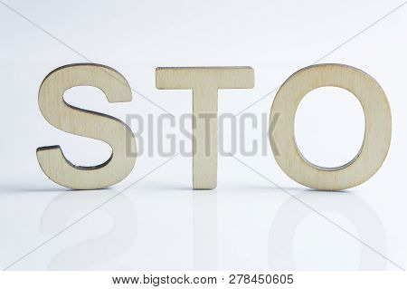 Security Token Offering Sto Sign With Wooden Letters, Ethereum Concept On White Background