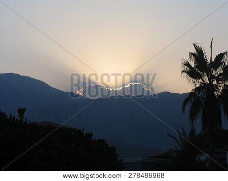 Captivating Cloud Beaming Sunset At Antalya Mountains, Turkey. Sun Beaming Through Cloud. Beautiful