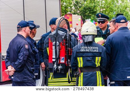 Vilnius, Lithuania - July 27, 2013: Police Officers Consulting Firefighters Before The Beginning Of
