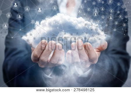 A Businesswoman Upper Half Is Standing And Holding A Cloud Surrounded By Wireless Connections At The