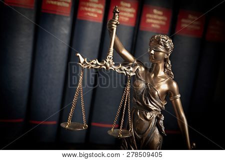 Statue Of Justice On Books Background