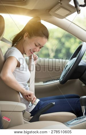 Young Asian Woman Driver Buckle Up The Seat Belt Before Driving A Car