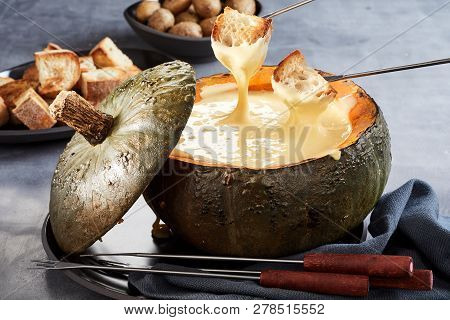 Hollowed Pumpkin Filled With Cheese Fondue