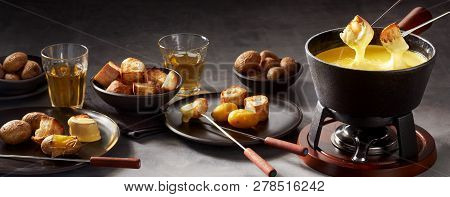 Panorama Banner Of A Cheese Fondue And Sides