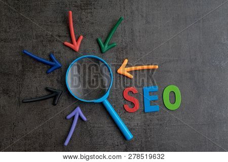 Seo, Search Engine Optimization Ranking Concept, Arrows Pointing To Magnifying Glass With Alphabets