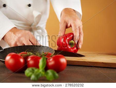 Chef Cutting A Fresh Red Sweet Pepper
