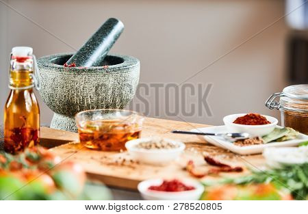 Stone Pestle And Mortar With Herbs And Spices