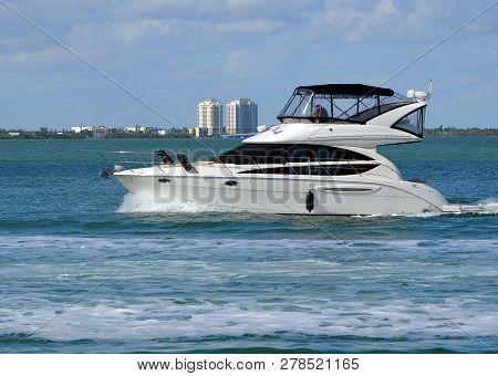 White Luxury Yacht Cruising The Florida Intra-coastal Waterway Off Miami Beach