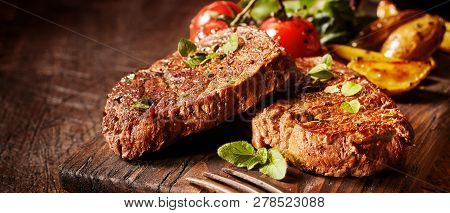 Panorama Banner With Succulent Medallions Of Beef