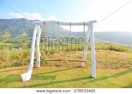 Empty Swing On Hillside With Morning Sunrise.