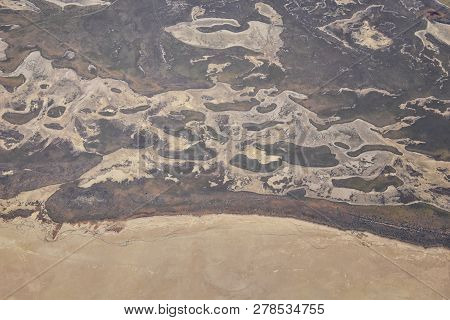 Aerial View Of Wasatch Front Rocky Mountain Landscapes On Flight Over Colorado And Utah During Winte