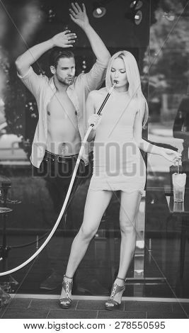 Couple Man With Girl At Shisha Cafe Lounge. Woman Sensual With Hookah Pipe In Bar. Date, Love, Relat