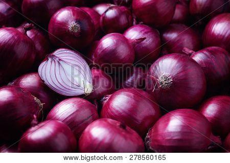 Full Frame Shot Of Purple Onions. Fresh whole purple onions and one sliced onion.