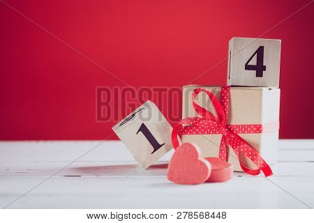 Concept Photography Of Valentines Gift With Wooden Calendar Shows The Date 14 February.