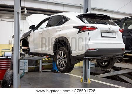 Russia, Izhevsk - April 21, 2018: Automobile Workshop. Scheduled Replacement And Wheel Alignment In