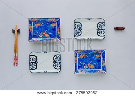 Set Of Ceramic Dishes On Table Background. Top View