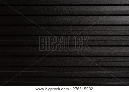 Wall Made Of Gray Metal Sheet. Zinc-like Used As A Fence To Divide Construction. Modern Style Backgr