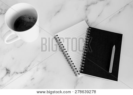 Flatlay Of Mini Spiral Notebooks With Pencil And Cup Of Coffee On Marble Desk Shot From A Top Down P