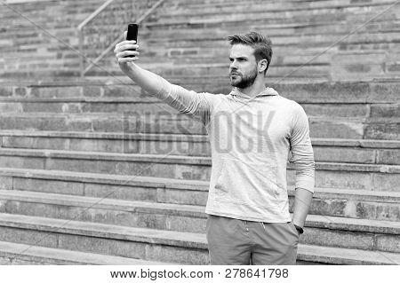 Selfie Concept. Handsome Man Take Selfie With Smartphone. Athletic Guy Use Mobile Phone For Selfie.
