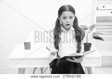 Such Difficult Topic. Studying Difficulties. Girl Read Book While Stand Table White Interior. School