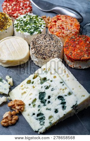 Assortment Of French Fresh White Soft Goat Cheeses With Different Tastes Topping Made With Herbs, Pa