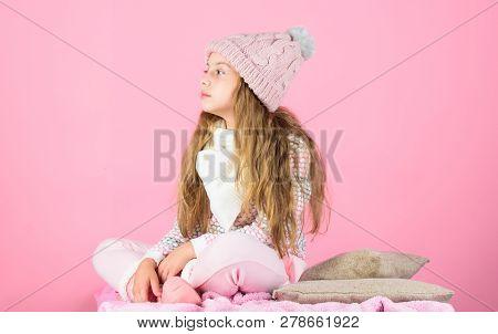 Child Long Hair Warm Woolen Hat Enjoy Warm. Kid Girl Wear Knitted Warm Hat Relaxing Pink Background.