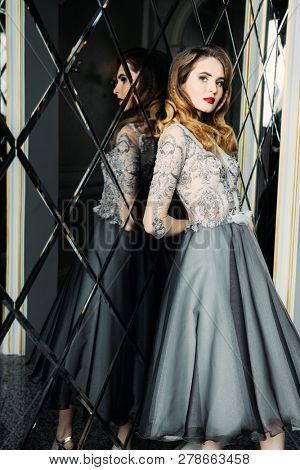 Portrait of a beautiful elegant woman in the evening dress. Fashion, evening dresses for events.